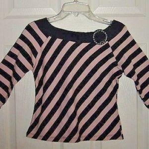 Black pink in color shirt top